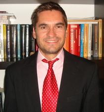 Dr Periklis Gogas